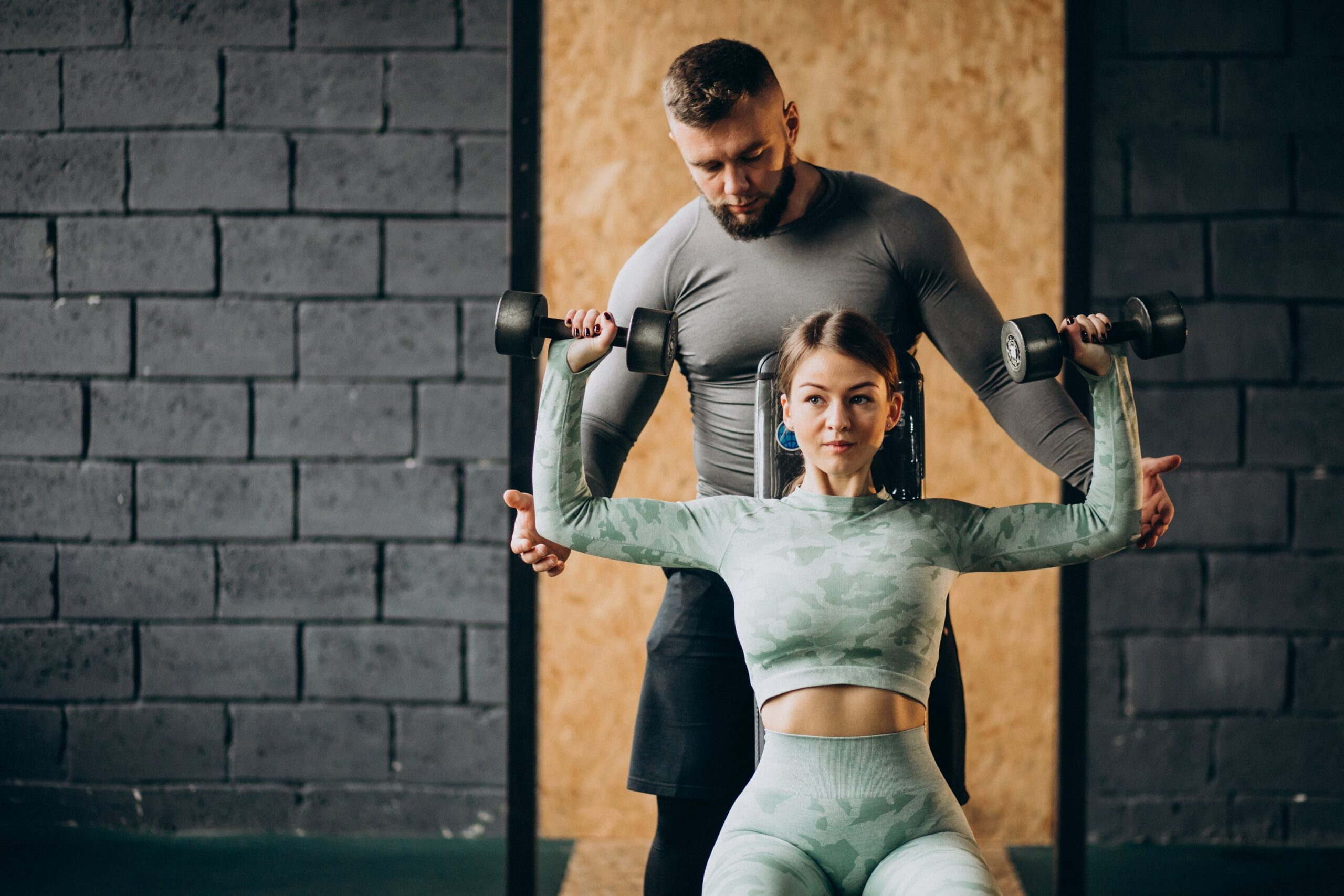 woman doing workout gym with trainer